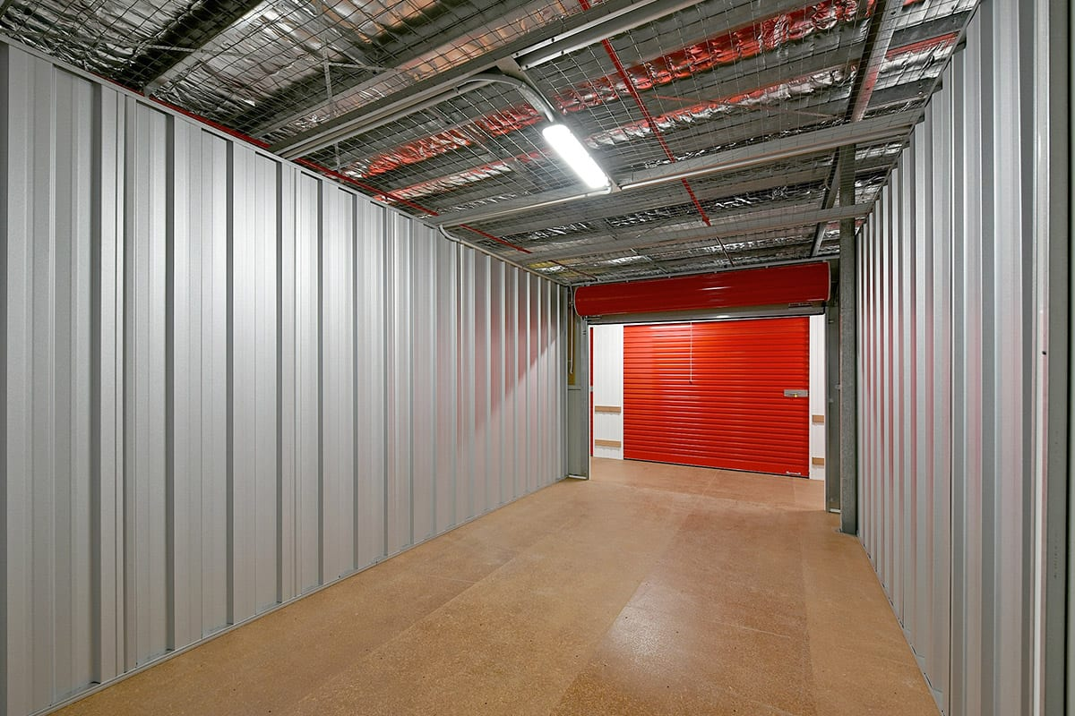 inside large storage unit with roller doors