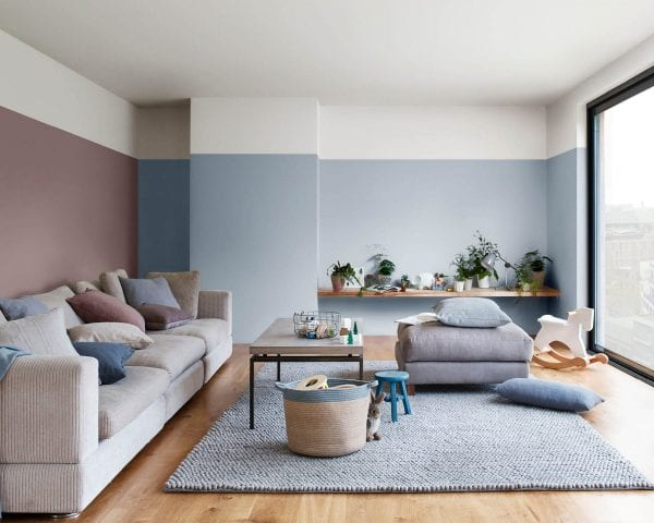 a simple modern living room with soft color maroon and blue color tones