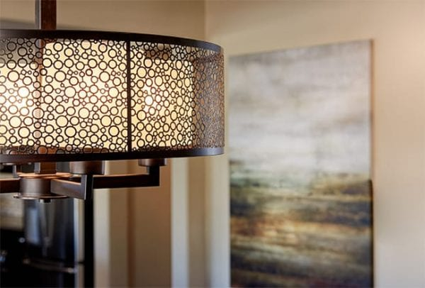 stylish lighting fixture beside a painting