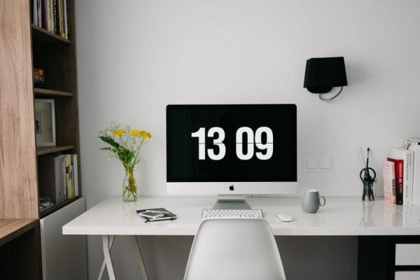 a home office computer showing the time of 13:09