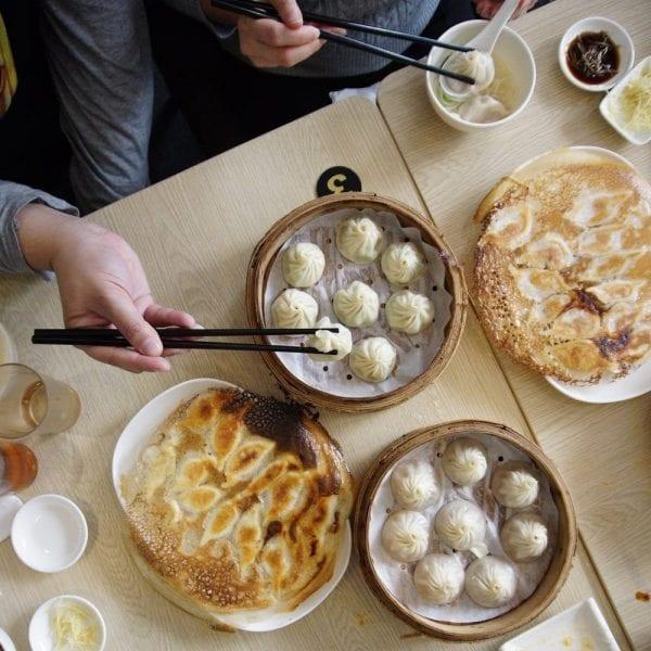 friends enjoying an dumplings for lunch