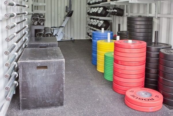 a make-shift gym with weights inside a storage unit