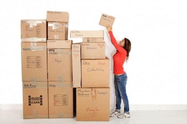 a woman stacking boxes