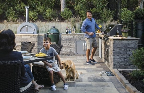 a family preparing dinner at their outdoor living space