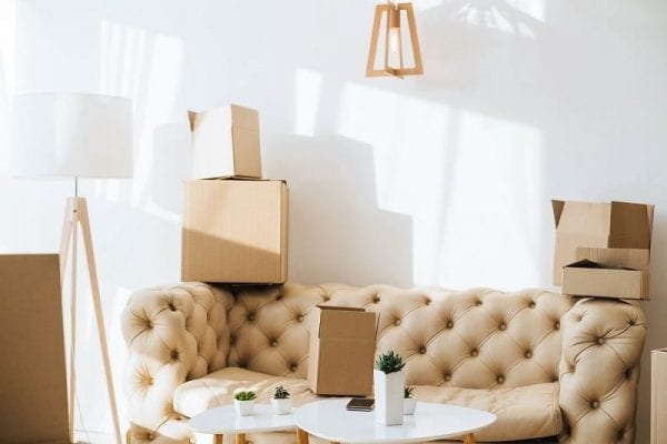 cardboard boxes placed on a couch