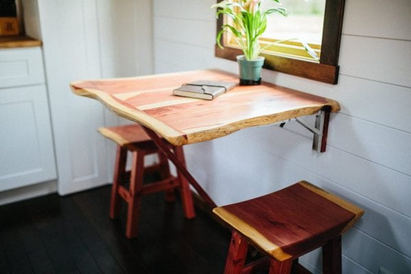 a space saving dining table in a tiny home