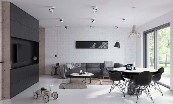 an open plan living space with black furniture