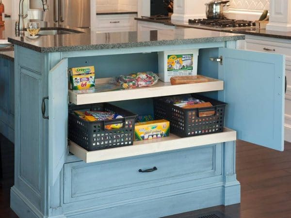 A hidden pantry storage in a kitchen table