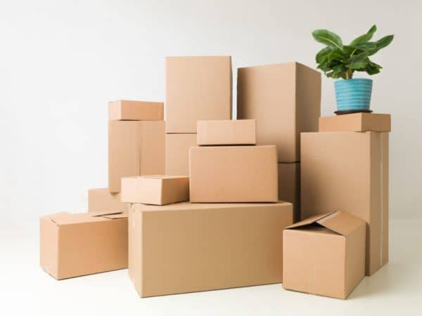 Cardboard boxes piled up in a corner