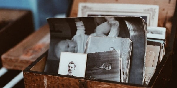 A box filled with antique pictures