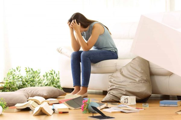 Woman surrounded with clutter