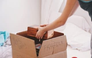 Packing books in a cardboard boxes