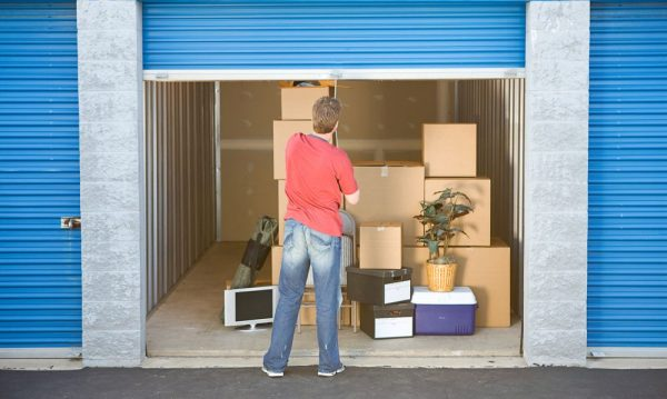 A man standing outside his storage unit